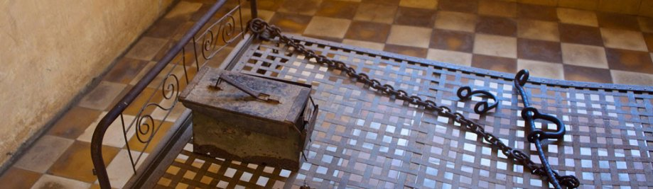 Bed in a cell in Tuol Sleng  (S21) Prison, Phnom Penh, Cambodia